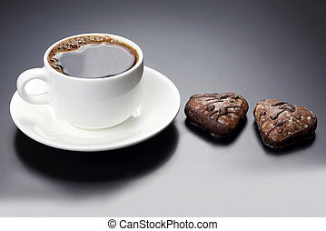 white cup of black coffee with biscuits heart