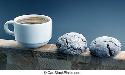 white Cup of black coffee with biscuits on a wooden frame