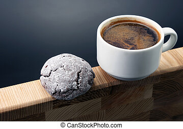white Cup of black coffee with cookies on wooden