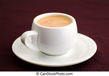 white cup of coffe on brown