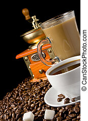 white cup of coffee, beans and grinder on black background