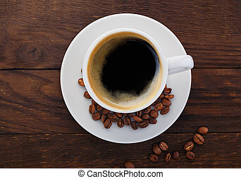cup of coffee grains on a wooden background