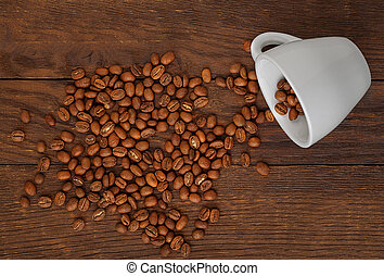 white cup of coffee grains wooden background