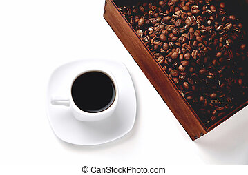 white cup of coffee on a white saucer, natural wooden box with coffee beans on a white background, isolate, angle view from above top