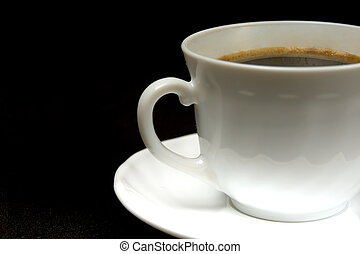 white cup of hot black coffee on a dark background