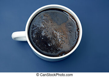 white Cup of hot black coffee on blue background