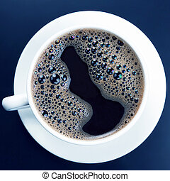 white cup of hot black coffee on dark background