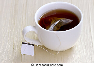White cup of tea and tea bag