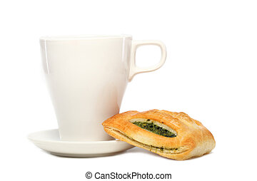 White cup of tea with buns