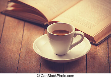 white cup of the coffee and vintage book.