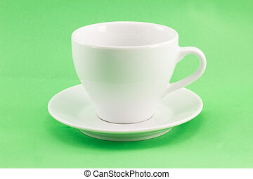 white cup on a green background