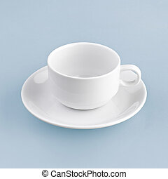 white cup on blue background