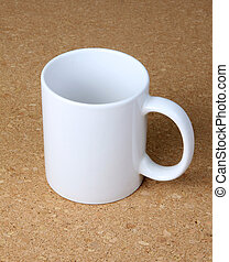 White cup on corkboard background.