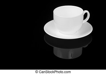 White cup on glossy black background