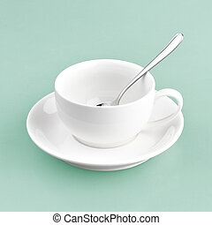 white cup on green blue background