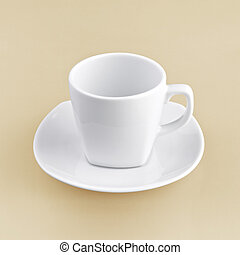 white cup on orange background