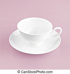 white cup on pink background