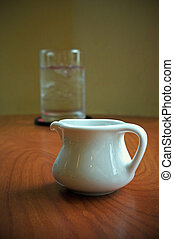 white cup on table