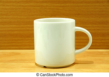 White cup on wood background