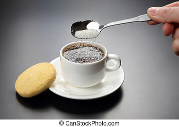 white cup with black coffee and spoon with sugar