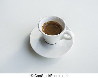 White cup with black coffee on white table.
