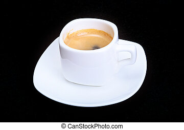 White cup with classic espresso coffee on black background. selective focus.