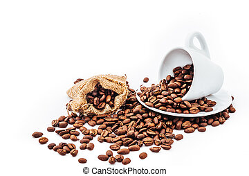 white cup with coffee beans isolated