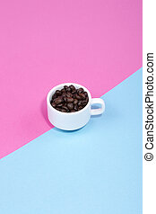 White cup with coffee beans on a colored background