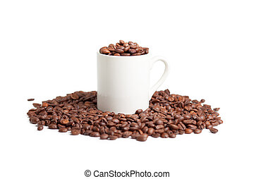White cup with coffee beans on a white background.