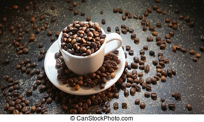 White Cup With Coffee Beans on Black Background