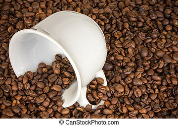 White cup with many coffee beans