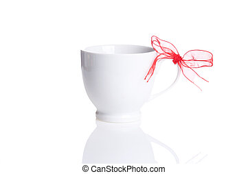 white cup with red bow on handle