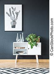White cupboard on black wall