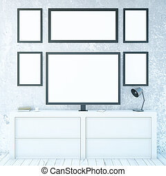 White cupboard with monitor and frames
