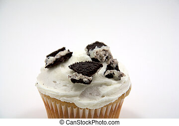 White cupcake with cookie topping - A white cupcake with...