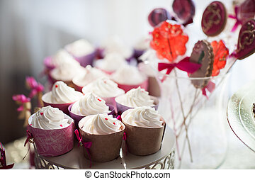 white cupcakes on a plate