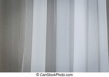 White curtain beside window
