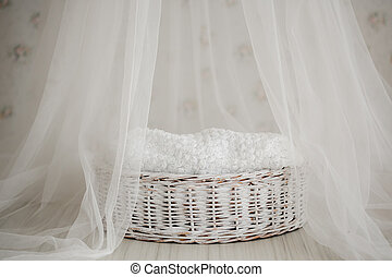 white cute cradle for a newborn. mattress for babies and healthy sleep in newborns