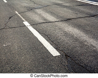 White dashed marking line on the old road
