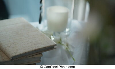 White decorated picture of candlestick and notebook like for wedding postcard or romance celebration ceremony. Vintage set of decoration with symbol of love, flame, nature and fashion portrait. Special day concept.