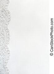 White Delicate satin background with lace border.