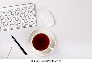 White Desktop With Keyboard, Mouse and Cup of Tea