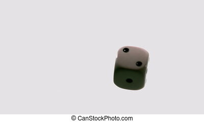 White dice falling and bouncing in slow motion