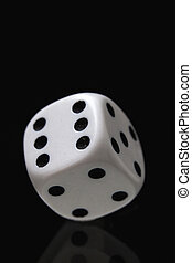 White dice on the black background.