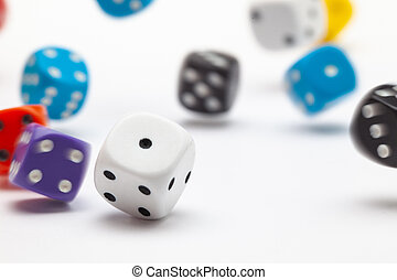 White dice on the white table.