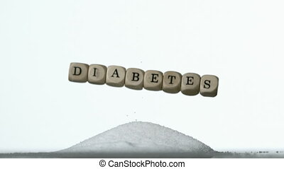 White dice spelling out diabetes fa