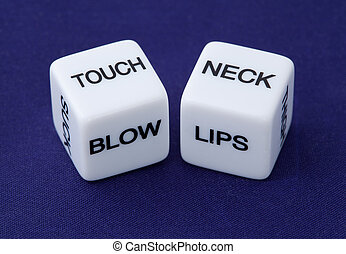 White dice with erotic messages on the sides on blue...