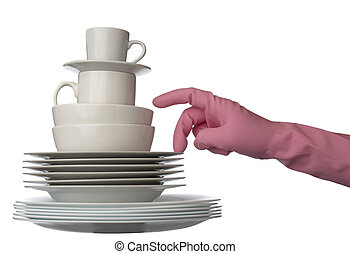 close up of stack of white ceramic dishes ready for fashing and hand in glove on white background with clipping path