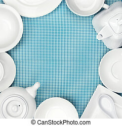white dishes on blue checkered tablecloth
