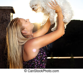 White dog and blond woman, outdoor